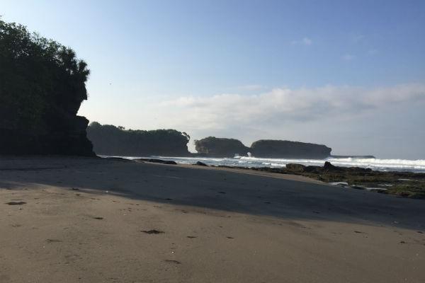 The black sand beach in front of Villa Bulung Daya