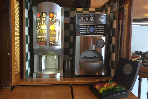 Coffee and juice dispenser at the breakfast buffet Hotel Ibis Calais