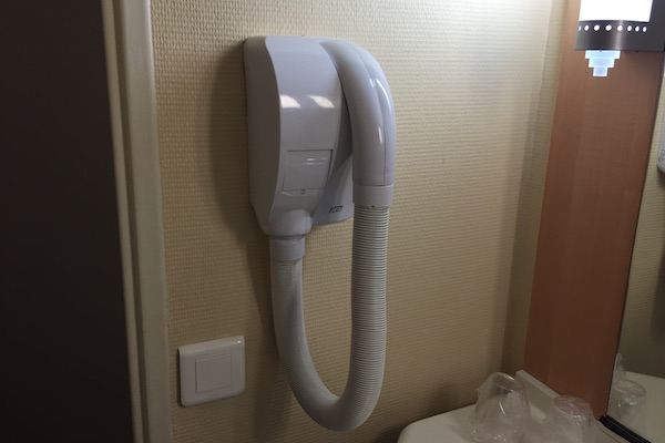 Giant hair dryer in the bathroom of the Ibis Calais Hotel