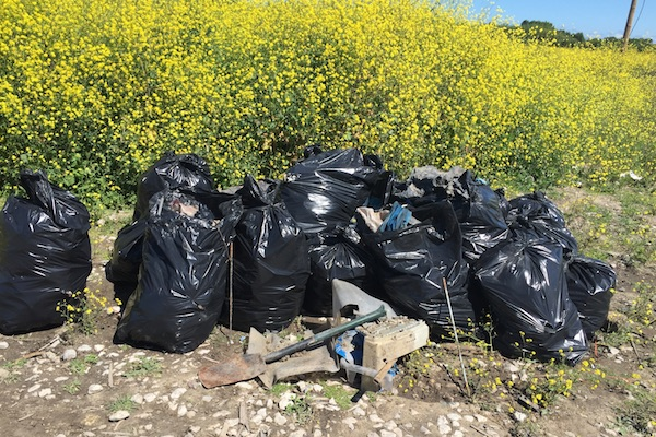 Full trash bags at the Calais Jungle refugee camp