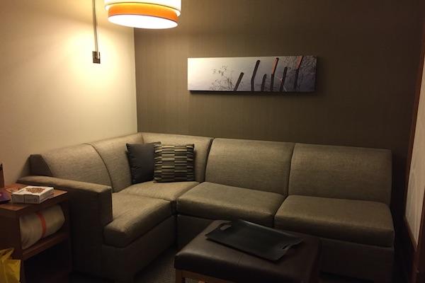 Hotel room sofa bed reading nook